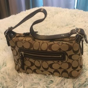 This is a lovely coach mini purse brown and beige